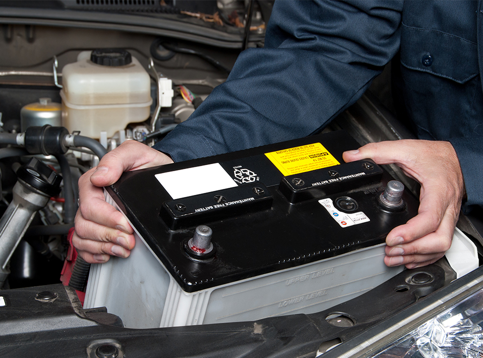 Mechanic fitting a battery - Car Batteries Nailsea
